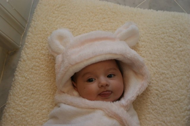 Ava Leigh, 3 months, looking snug as a bug in her cozy hooded bath towel with ears.