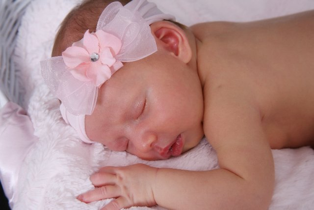 Baby Courtney looks so peaceful as she snuggles her pink Luxe blanket.