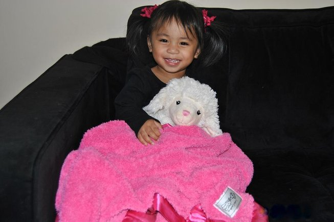 The adorable Miss Isabella Jules, 22 months, enjoying her first LG Raspberry Chenille blanket!