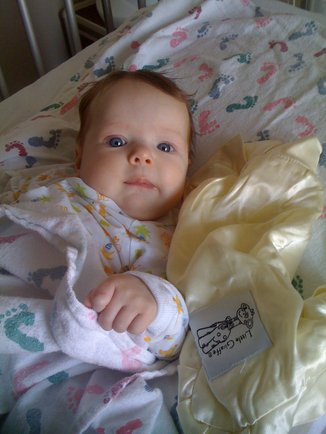 Darling Maisy loved snuggling with her Little Giraffe blanket while fighting RSV in the hospital