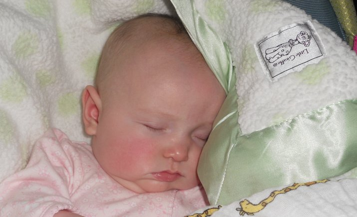 Sweet Evelyn sleeping away with her Little Giraffe blanket