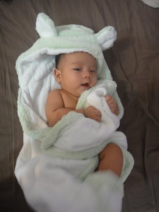 Love this little cutie snuggled-up in our Luxe Towel after a bath